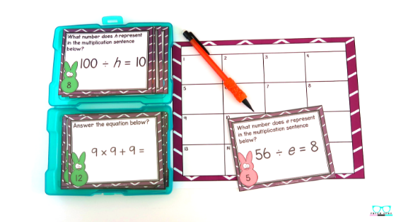 Third-grade Easter two-step word problem task cards stored in an affordable photo box.