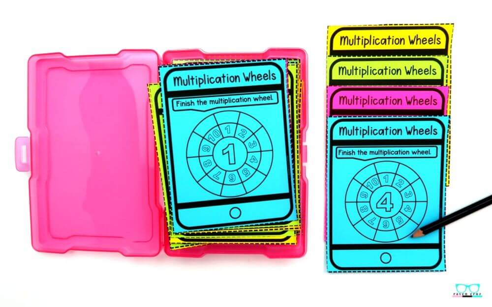 Multiplication wheel task cards printed on colored paper.